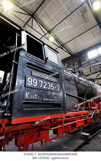 Historic steam locomotive in the workshop building, depot of the HSB, Harzer Schmalspurbahnen narrow-gauge railway, Wernigerode, Harz, Saxony-Anhalt, Germany