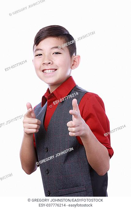 A confident young boy gives a cool finger point to the camera