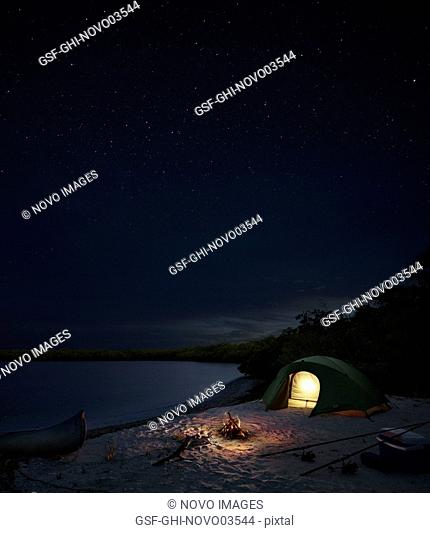 Tent and Campfire on Tropical Island at Night