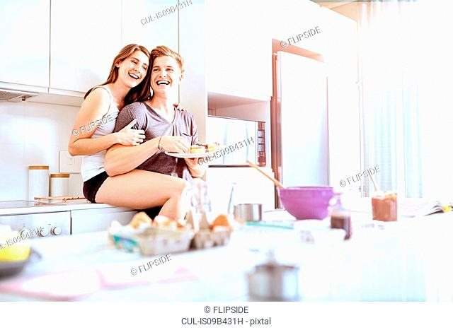 Couple sharing food in kitchen