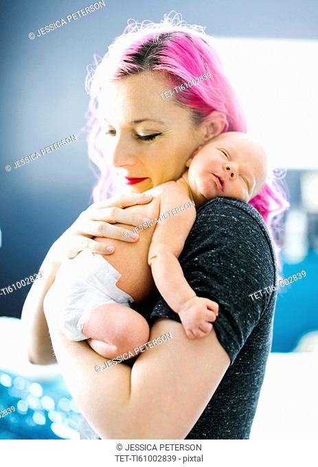 Mother embracing newborn son (2-5 months)