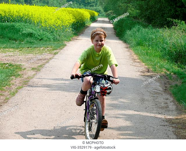 girl is riding her bicycle - 02/05/2009