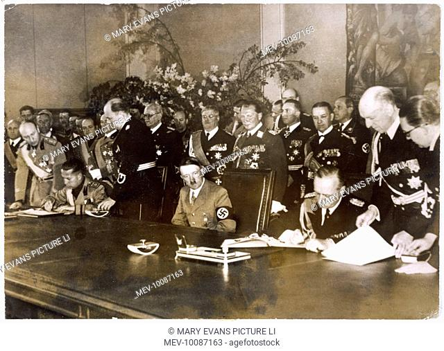At the signing of the Berlin- Rome Military Alliance.  Hitler sits between Von Ribbentrop (left) and Count Ciano (right)