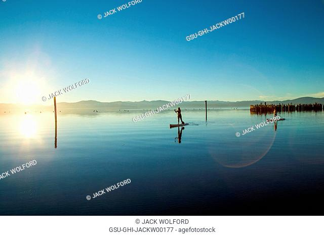 Mother and Daughter on Paddle Boards on Calm Water, Lake Tahoe, Nevada, USA