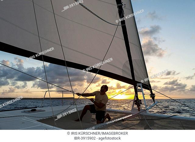 Skipper checking the tension of the sails, Grande Terre, Guadeloupe