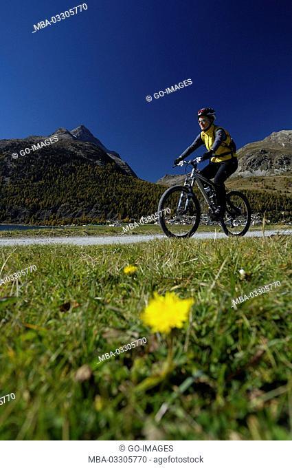 Mountain biker at Lake Silvaplana, the Engadine Switzerland