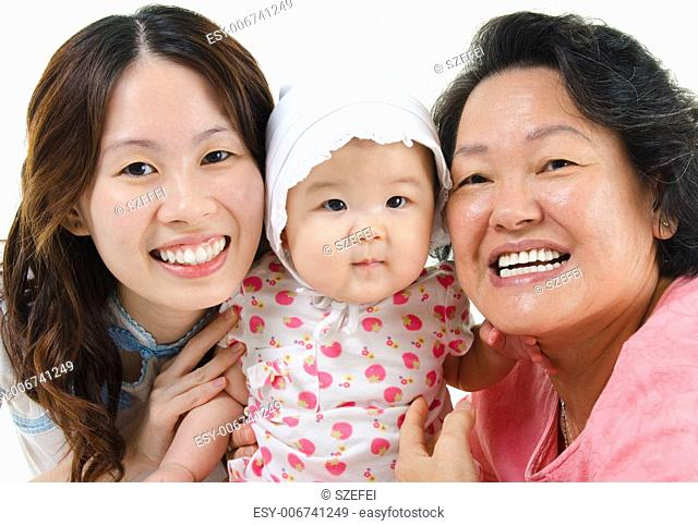 Happy Asian family isolated on white. Three generations Asian family, grandmother, mother and granddaughter