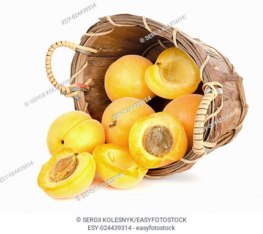 Apricots in a basket isolated on a white background