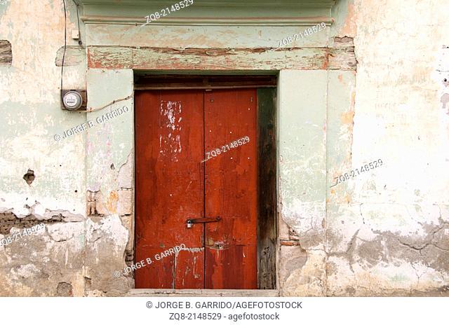 Wooden beautiful door in an old building, Oaxaca Mexico