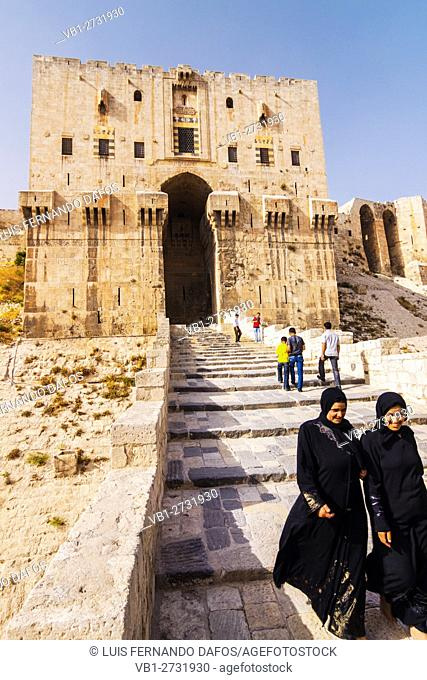 Two Syrian women wearing hejab at the keep of the Citadel of Aleppo, Syria