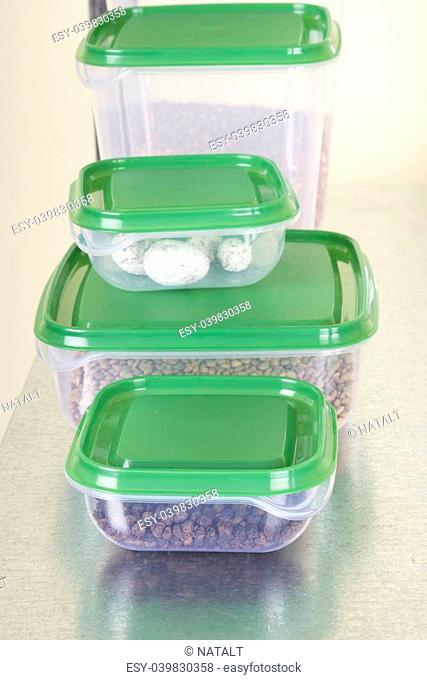 Filled plastic containers on the shelf