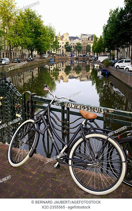 Netherlands, province of North Holland, Amsterdam, bicycle parked at the bridge