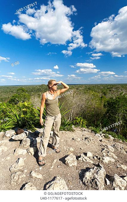 Guatemala, Peten, El Mirador Basin, woman looking out from top of Temple