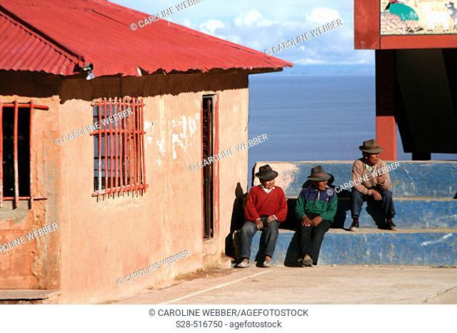 Men on Isla Amantani, Lake Titicaca, Peru