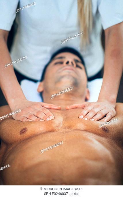 Sports massage. Physical therapist massaging man's chest