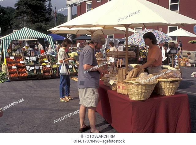farm market, Vermont, VT, A man buys bread at the Saturday Farmers Market in Montpelier