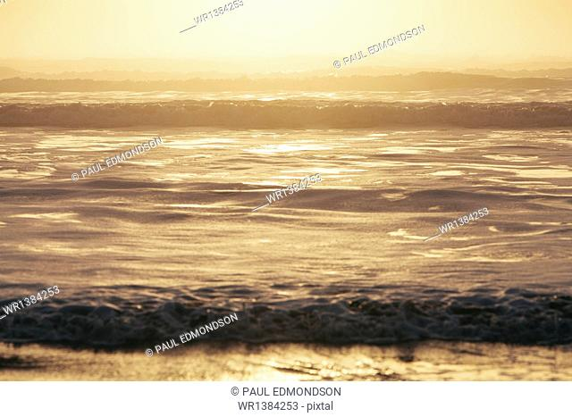Seascape at dusk, Waves breaking on the shore. Tidal zone. Off the shores of the Olympic National park, in Washington, USA