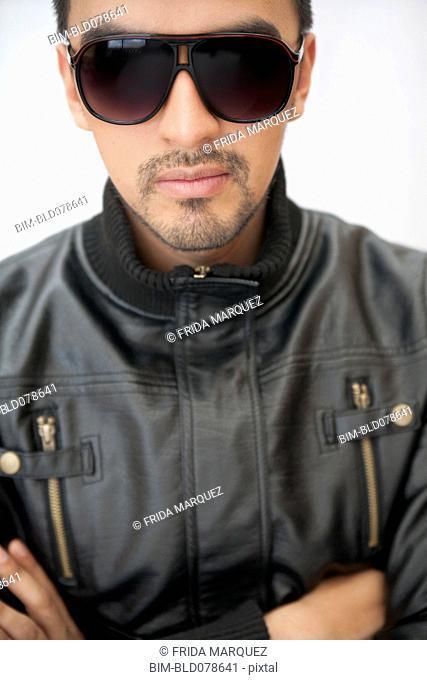 Hispanic man in sunglasses and leather coat