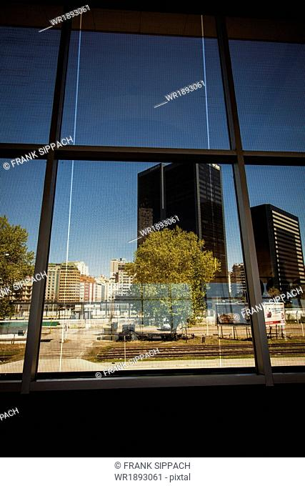 Office building seen through window, Buenos Aires, Argentina, South America