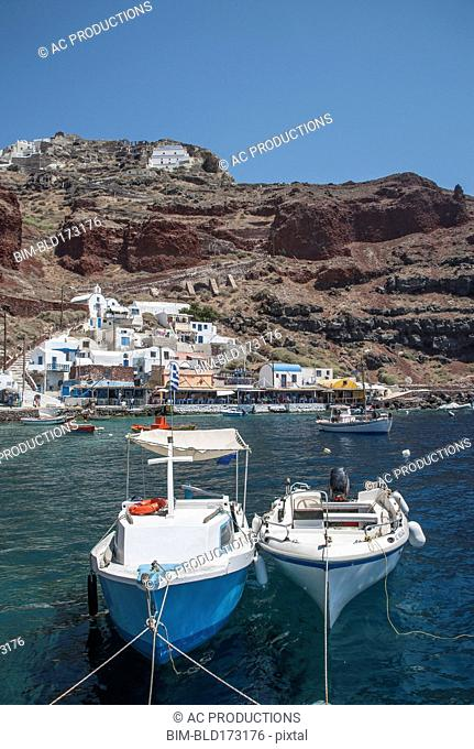 Boats in Santorini bay, Cyclades, Greece