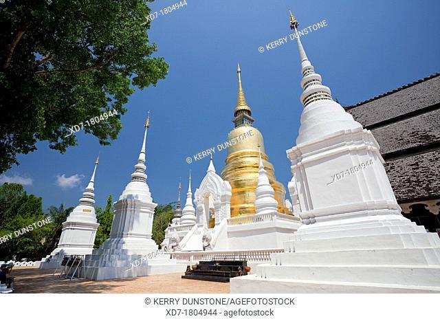 Golden chedi and white stupas, Wat Suan Dok Flower Garden Temple, Chiang Mai, Thailand