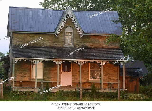Country house and verandah at sunrise, Wonderland Road, near London, Ontario, Canada