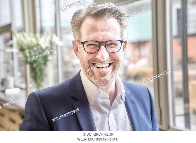 Portrait of happy mature businessman