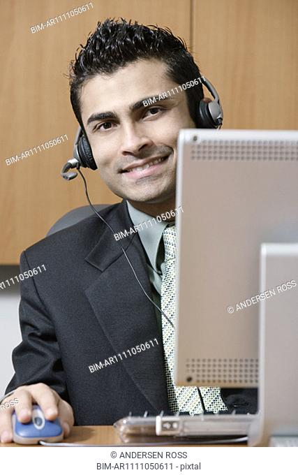 Businessman wearing a headset at work