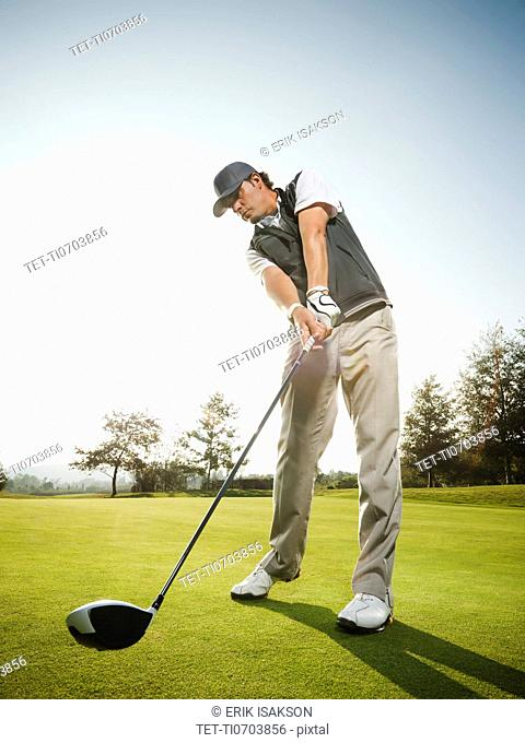 USA, California, Mission Viejo, Low angle view of man playing golf