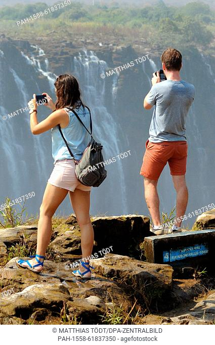 Tourists visiting the Zimbabwean side of the the Victoria Falls, pictured on 30.07.2015. The Victoria Falls are the broad waterfalls of the Zambezi at the...