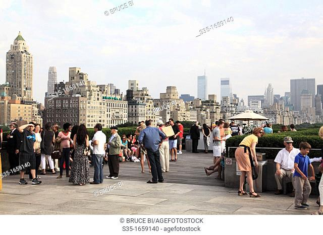 Visitors on the rooftop sculpture garden at the Metropolitan Museum of Art  New York City  USA