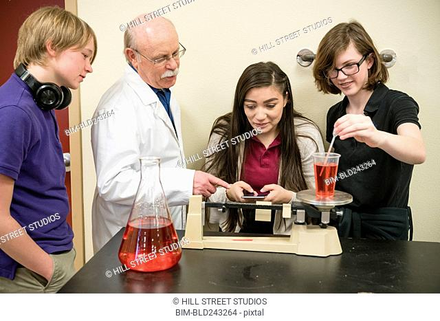 Teacher assisting students in science class