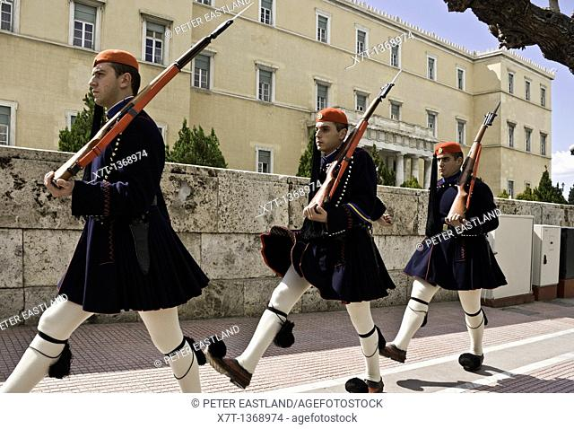 Evzones marching back to barracks from Syndagma square in the center of Athens, Greece The Evzones are an elite core of Greek soldiers used to guard the tomb of...