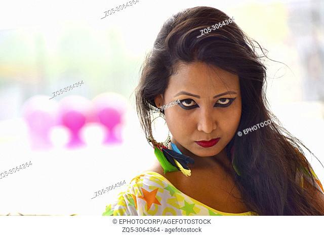 Indian girl looking at camera, Pune