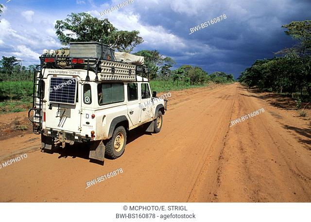 Landrover on a red african dirt road, Tanzania