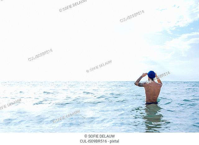 Swimmer getting ready to go into sea