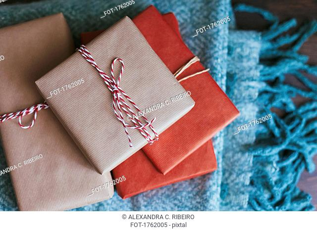 Stack of wrapped Christmas presents on a blanket