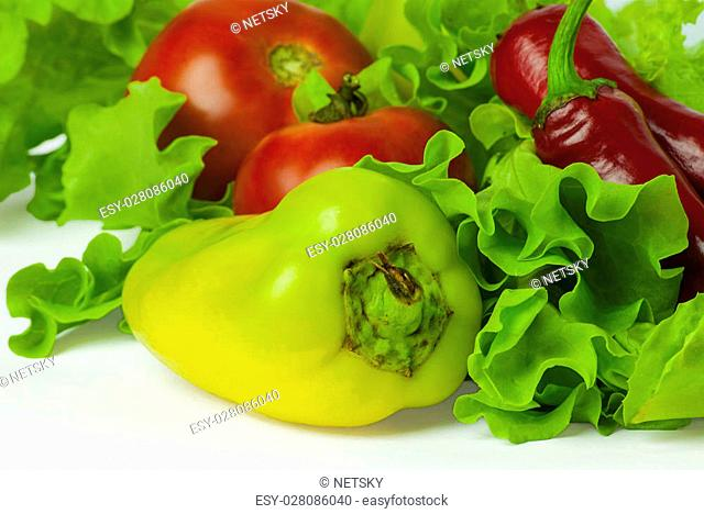 fresh vegetables on a white background, salad, tomatoes, chili peppers