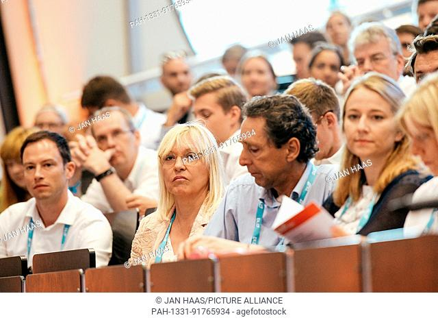 BAYREUTH/GERMANY - JUNE 21: Dr. Beate Merk (Free State of Bavaria, m.) sit in the audience listening to the speaker during the DLD Campus event at the...