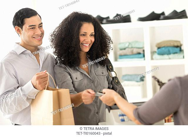 Customers and sales clerk in store