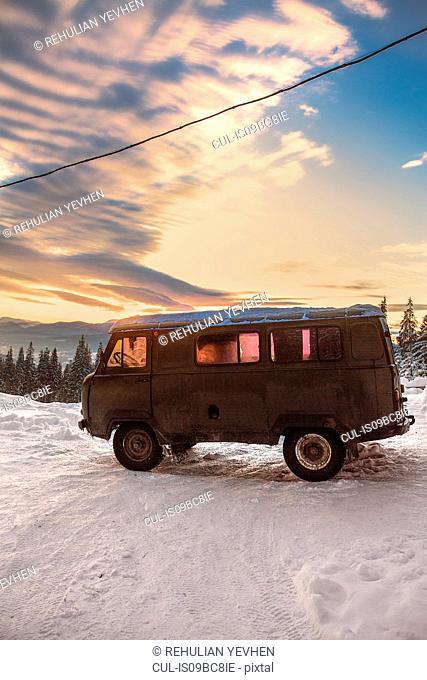 Camper van on covered landscape at sunset, Gurne, Ukraine, Eastern Europe