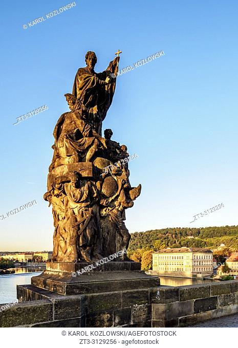 Sculpture at Charles Bridge, sunrise, Prague, Bohemia Region, Czech Republic