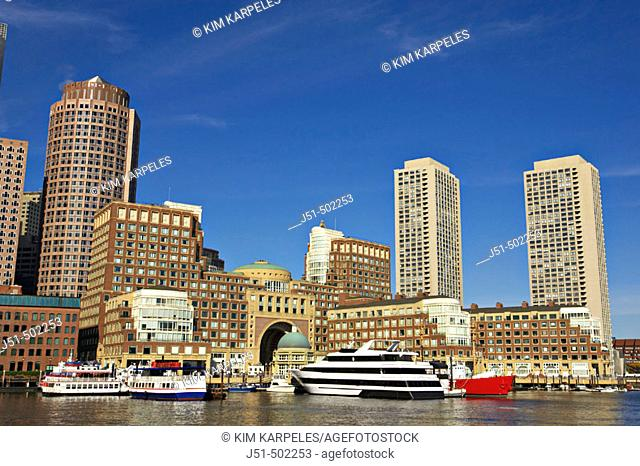 Massachusetts, Boston, City skyline viewed from Fan Pier, skyscrapers, boats docked along waterfront, Boston Harbor Hotel at Rowes Wharf