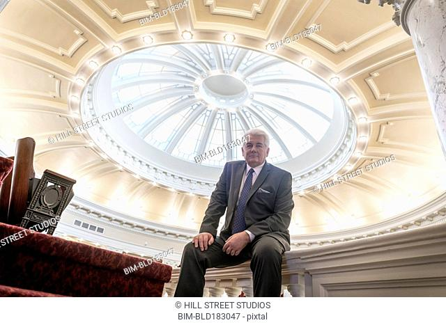 Caucasian politician sitting in capitol building