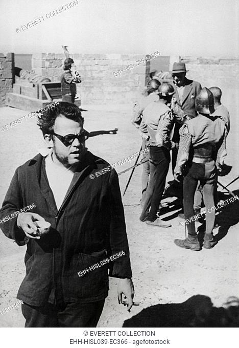 Orson Welles directing the 1952 film, 'Othello'. He was filming the ramparts and cannons of the Portuguese Fort at Nagador, Morocco