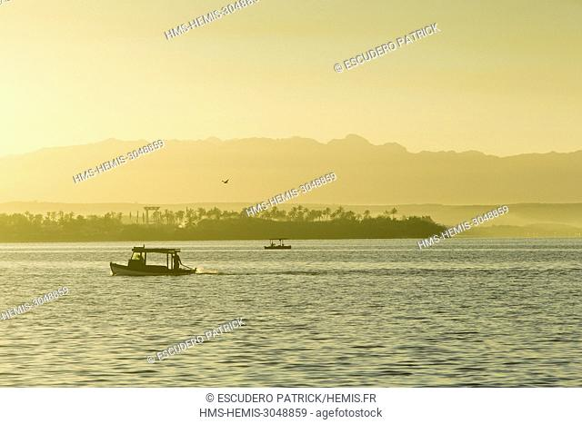 Cuba, Cienfuegos province, Cienfuegos, sunrise on Cienfuegos bay from Punta Gorda and Escambray mountain range in the background