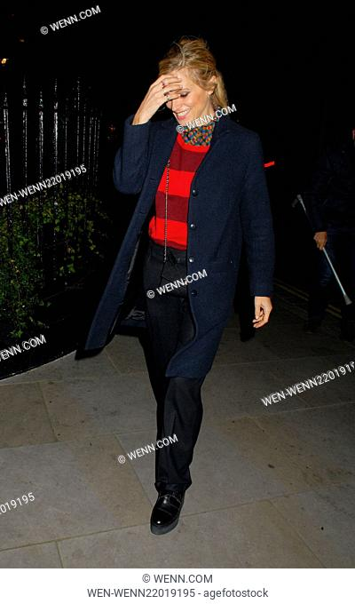 An embarrassed Laura Bailey limps as she arrives at Chiltern Firehouse restaurant in Marylebone walking with the aid of a crutch
