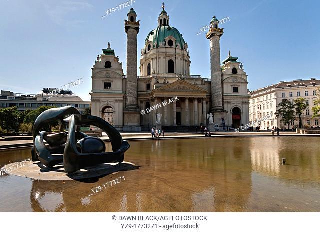 Hill Arches sculpture Henry Moore, 1978 and the Karlskirche, Karlsplatz, Vienna, Austria