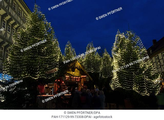 Visitors stand in front of the 'Christmas forest' at the Christmas market in Goslar, Germany, 29 November 2017. The Christmas market in Goslar is open from 29...