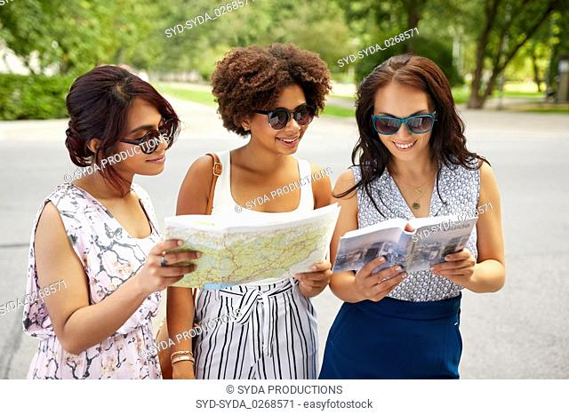 happy women with city guide and map in summer